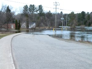 River Road near Taylor Road, Bracebridge disappearing into the Muskoka River